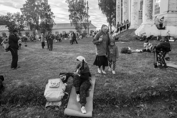The  girl near   mother (resting) after  trekking, 35 km long   (Christian Procession)  this day  thumbnail