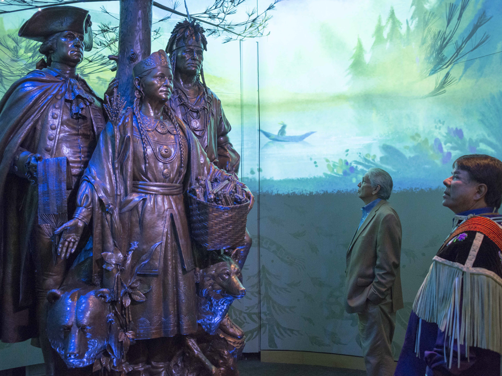 """Kevin Gover, director of the National Museum of the American Indian, and Ray Halbritter, Oneida Indian Nation representative and CEO of Oneida Indian Nation Enterprises, at the dedication of the new interpretive sound, light, and imagery around the sculpture """"Allies in War, Partners in Peace."""" (Katherine Fogden [Mohawk], National Museum of the American Indian)"""
