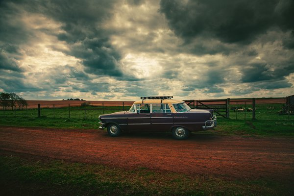 Old car in the countryside thumbnail