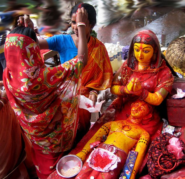 Married women are exchanging holy sindur on the occasion of Janmastami festival. thumbnail