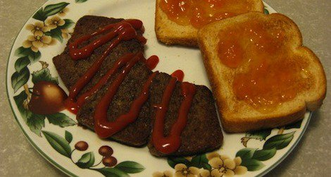 Snowpocalypse scrapple with ketchup, served with a side of toast.