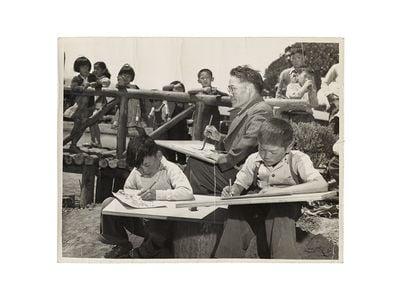 Photograph of Chiura Obata teaching a children's art class at Tanforan Art School, 1942 / unidentified photographer. Chiura Obata papers, circa 1891-2000, 1942-1945. Archives of American Art, Smithsonian Institution.