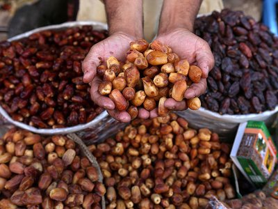 A vendor offers dates for sale on a roadside, as Muslims across the world prepare for the holy month of Ramadan, in Peshawar, Pakistan.