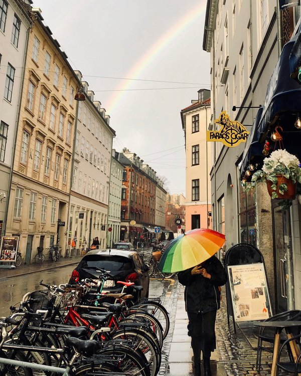 Woman with a rainbow umbrella in Copenhagen thumbnail