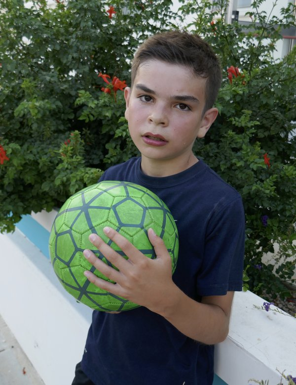 Resting on a wall after playing soccer thumbnail