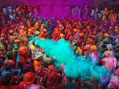 During Holi, people crowd the streets and splash brilliantly colored dyes on anyone walking by.