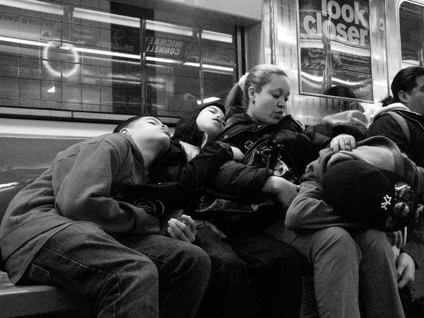 A family on the 7 train at 4am. thumbnail