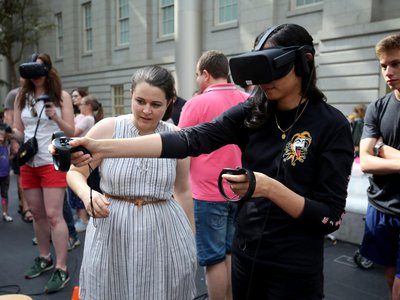 Testing out Virtual Reality at SAAM Arcade 2018. Photo by Libby Weiler.