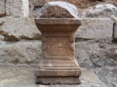 The altar's inscription suggests pilgrims traveled great distances to reach the religious site.