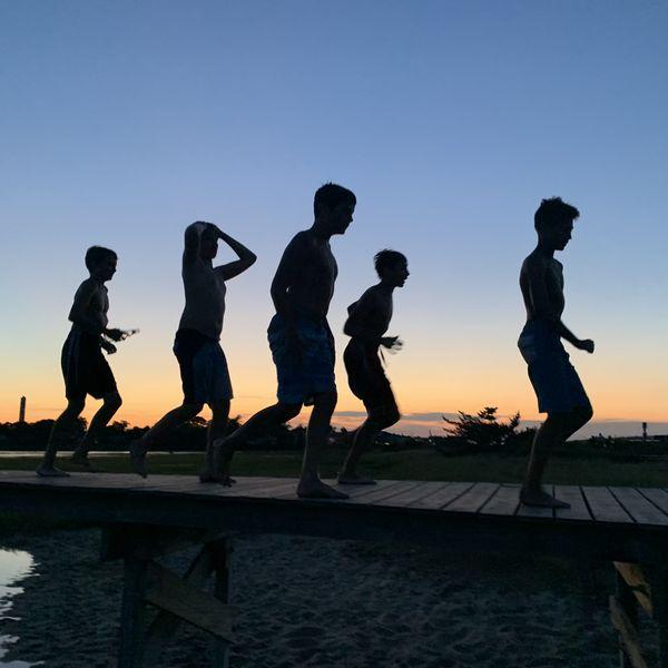 Boys being boys on a boardwalk thumbnail