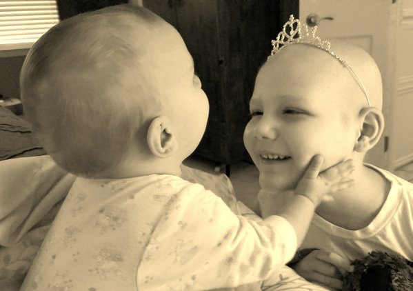 Two sisters that love each other and make each other happy during a tough time. thumbnail