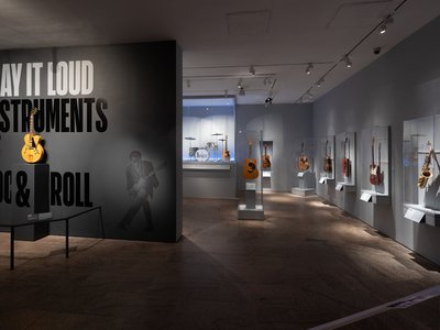 """Installation view of """"Play It Loud: Instruments of Rock and Roll"""""""