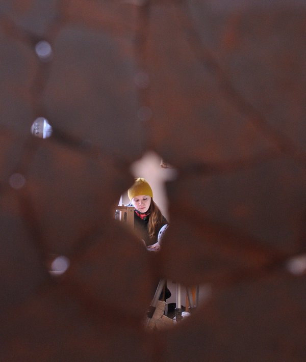 Girl was photographed through the wall of a clay vessel. thumbnail