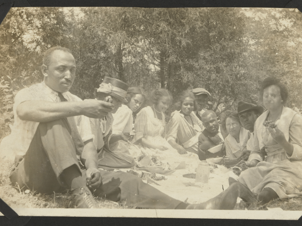 Group of people having a picnic in the 1920s