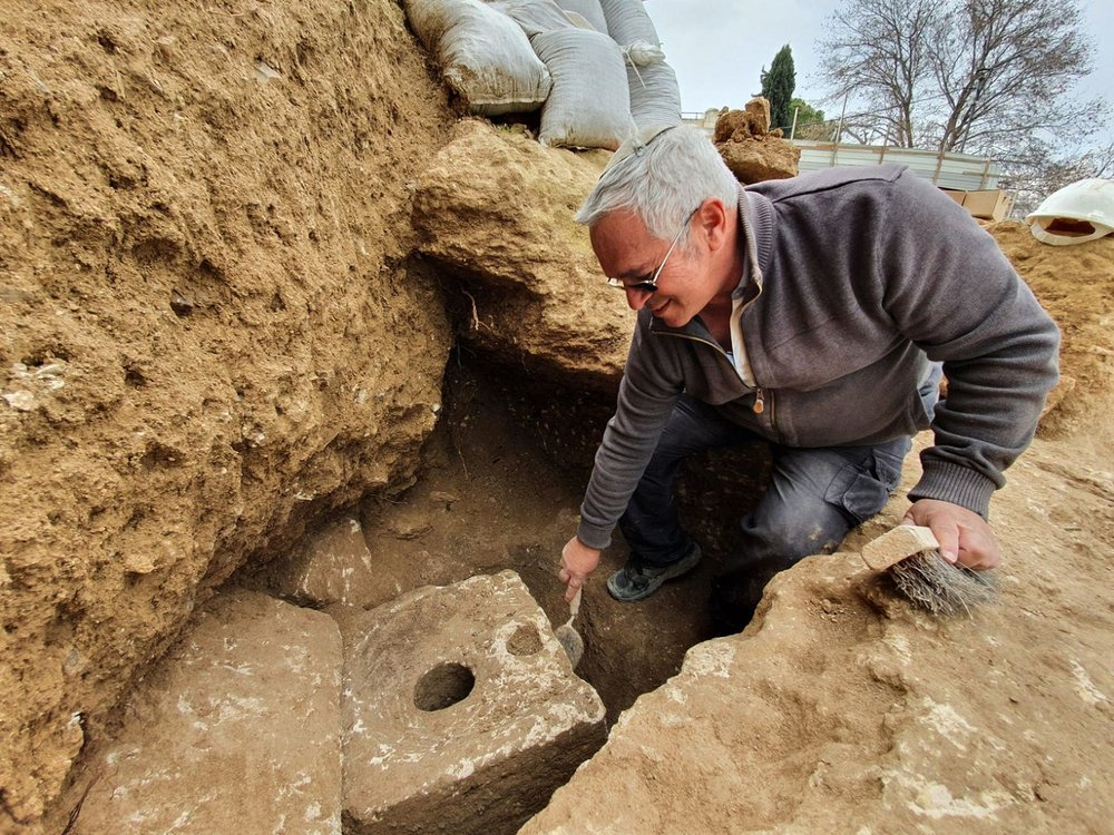 Archaeologists examines the toilet