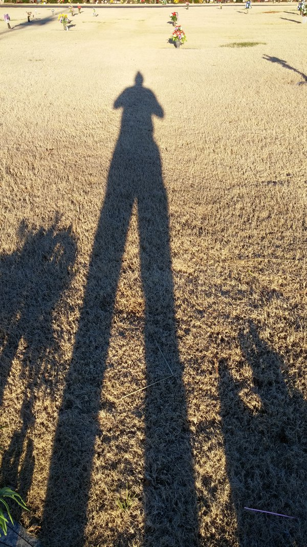 my long shadow of sorrow at my Mothers and Nephews gravesite2 thumbnail