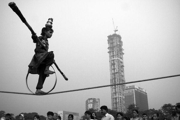 Teenage gypsy girl performing a balancing trick at the Maidan thumbnail