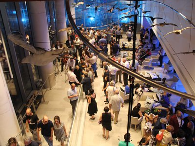 """A crowd gathers in the """"Bird Migration"""" exhibit at the Steinhardt Museum during the inauguration event."""