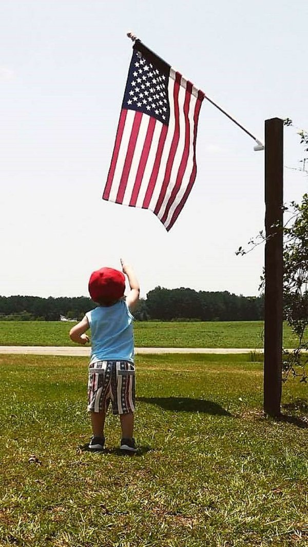 Young Patriot admiring the flag for the first time. thumbnail