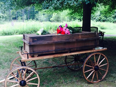 """This casket was made from reclaimed wood. At """"green cemeteries"""" around the country, there is a movement to use fewer harmful chemicals and non-renewable resources in funerals and burials."""