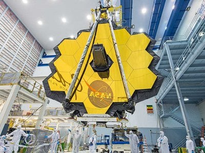 Webb's 18 mirror segments can lock into the largest telescopic mirror humankind has ever built.