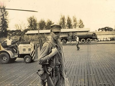On his last day of service in Vietnam in 1963, Harvey Pratt (Cheyenne and Arapaho) poses in Da Nang carrying his rappelling rope that he used to descend from helicopters to clear landing fields. Pratt is the designer of the National Native Americans Veterans Memorial.