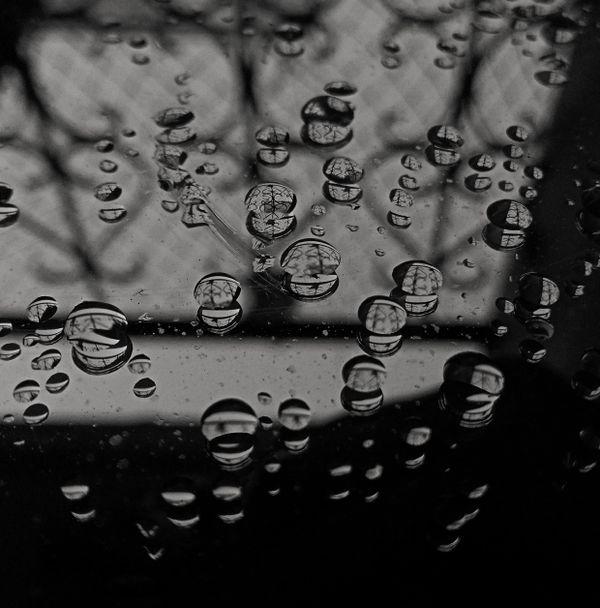 Rain drops falling on mirror thumbnail