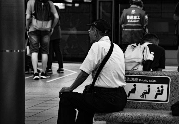 Resting grandpa in a busy train station thumbnail