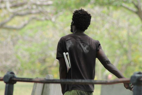 A Homeless Man Walking through the Park thumbnail