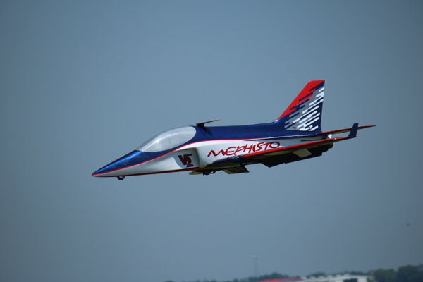 Model RC jet in fly by at air show in Lakeland, fl thumbnail
