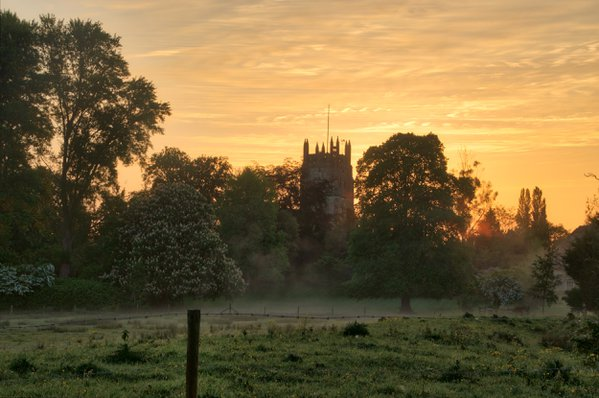 Sunrise over an old church in an English village. thumbnail