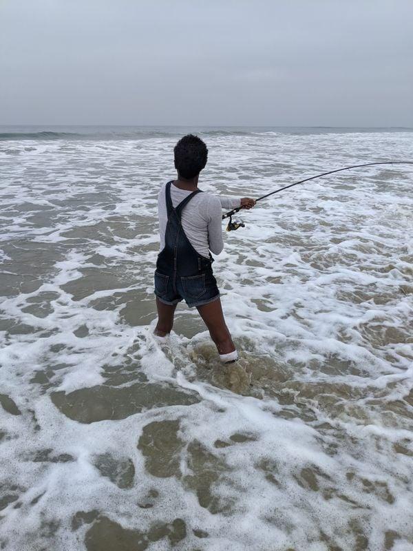 Surf fishing an overcast morning at Moonlight Beach. thumbnail