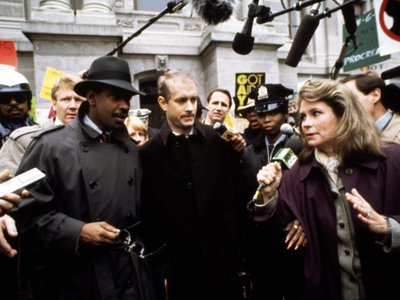 Tom Hanks (center) won an Oscar for his portrayal of Andrew Beckett, a gay man suffering  from AIDS.