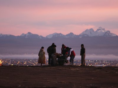 Aymara people prepare an offering to Mother Earth during the sunrise of the winter solstice ceremony in La Apacheta, El Alto, on the outskirts of La Paz.