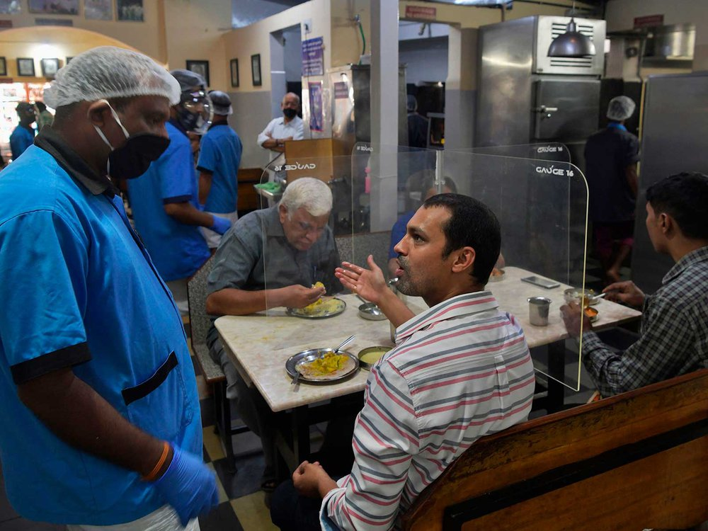 Man Talks in Restaurant During COVID-19 Pandemic