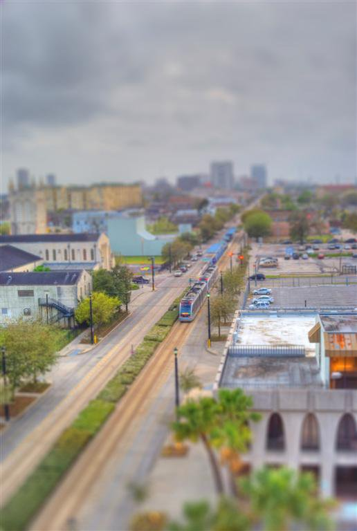 From the top of a building, the metro commuter train becomes a plaything. thumbnail