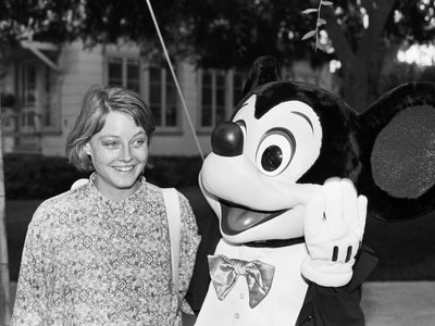 Actress Jodi Foster in 1985 with an interactive Mickey Mouse created the old fashioned way.