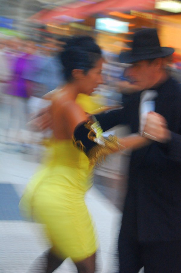 Tango pair at twilight on the streets of Buenos Aires. thumbnail