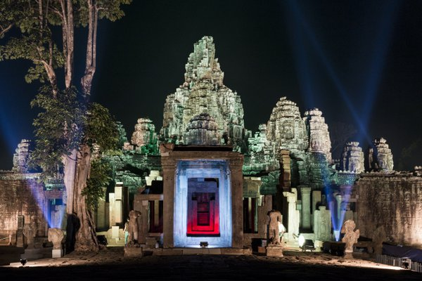 Bayon temple of Angkor Archeological park in Cambodia at night during the Khmer New Year celebration thumbnail
