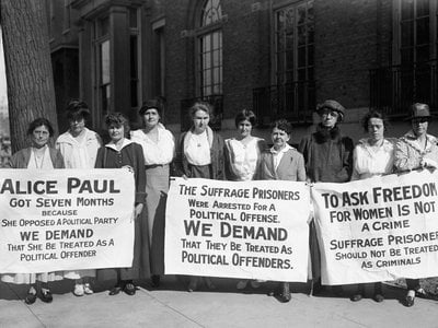"""Shortly before the """"Night of Terror,"""" suffragists (including Lucy Burns, second from left) protested the treatment of Alice Paul, who was kept in solitary confinement in a D.C. prison."""