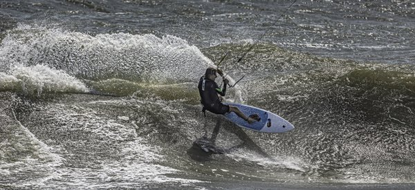 A Kite Surfer in a competition in the rough waves of Outer Banks, North Carolina. thumbnail