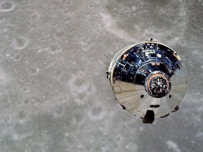 """The Apollo 10 Command Module, """"Charlie Brown,"""" as seen from the detached Lunar Module, """"Snoopy."""""""
