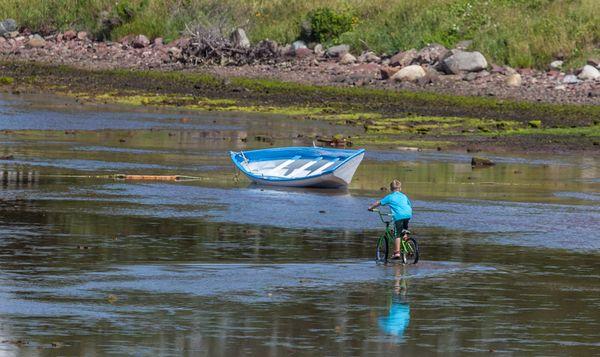 kid riding his bike at low tide thumbnail