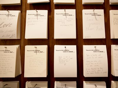 Visitors leave hand-written notes after viewing the exhibition,