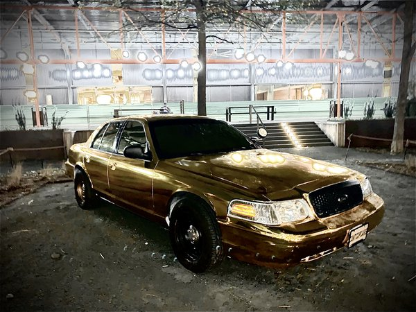 Cop car wrapped in gold thumbnail