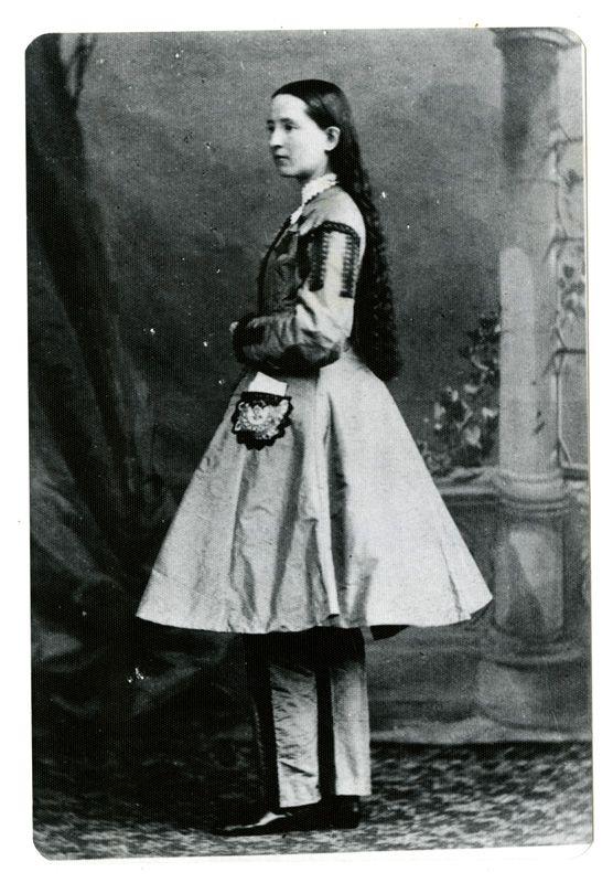 Black and white photo of girl in knee-length dress