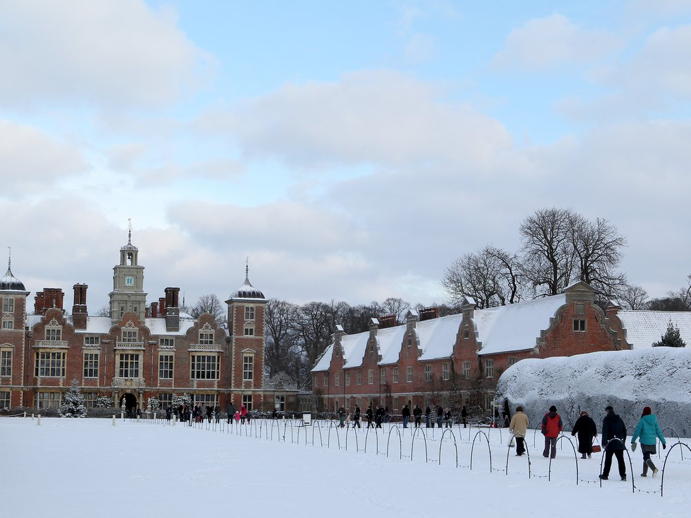 People enjoy the recent heavy snowfall at Blickling Hall in Norfolk