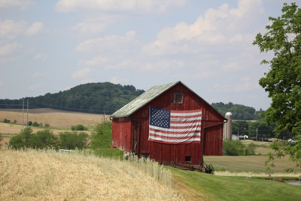 America the Beautiful.  An old barn with Old Glory displayed proudly.  thumbnail