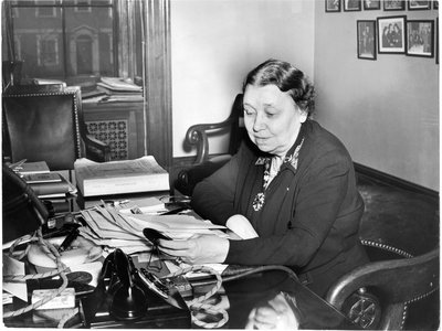 Hattie Caraway succeeded her husband as an Arkansas senator and then won re-election with more votes than her six male opponents combined. She's pictured at her desk in 1943.