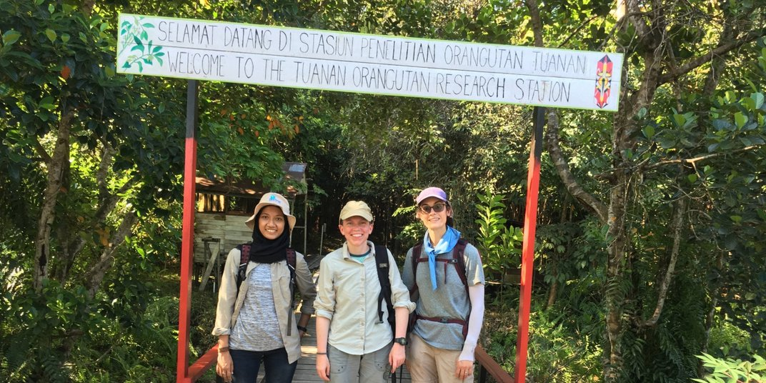 Dr. Meredith Bastian (center) and Alex Reddy (right) at the Tuanan Orangutan Research Center